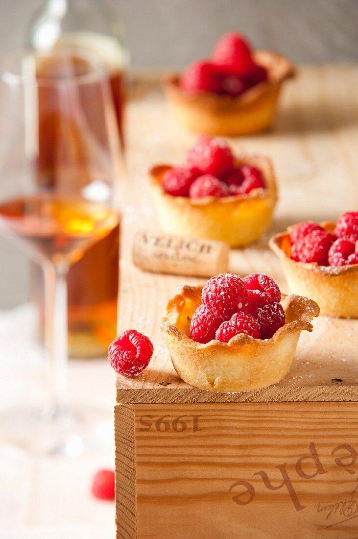 Raspberry tartlets and dessert wine