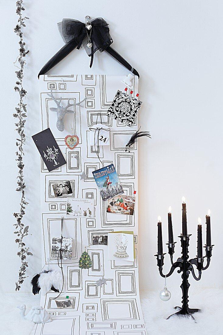 A Christmas card display hanging on the wall