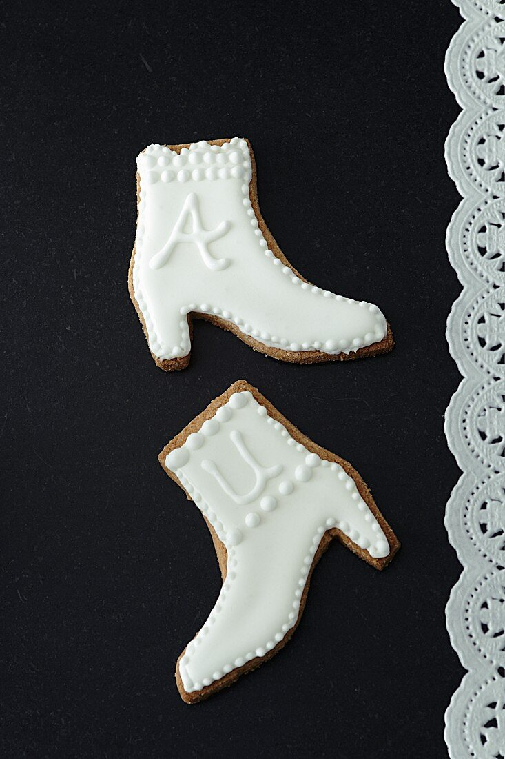 Boot-shaped biscuits with white icing