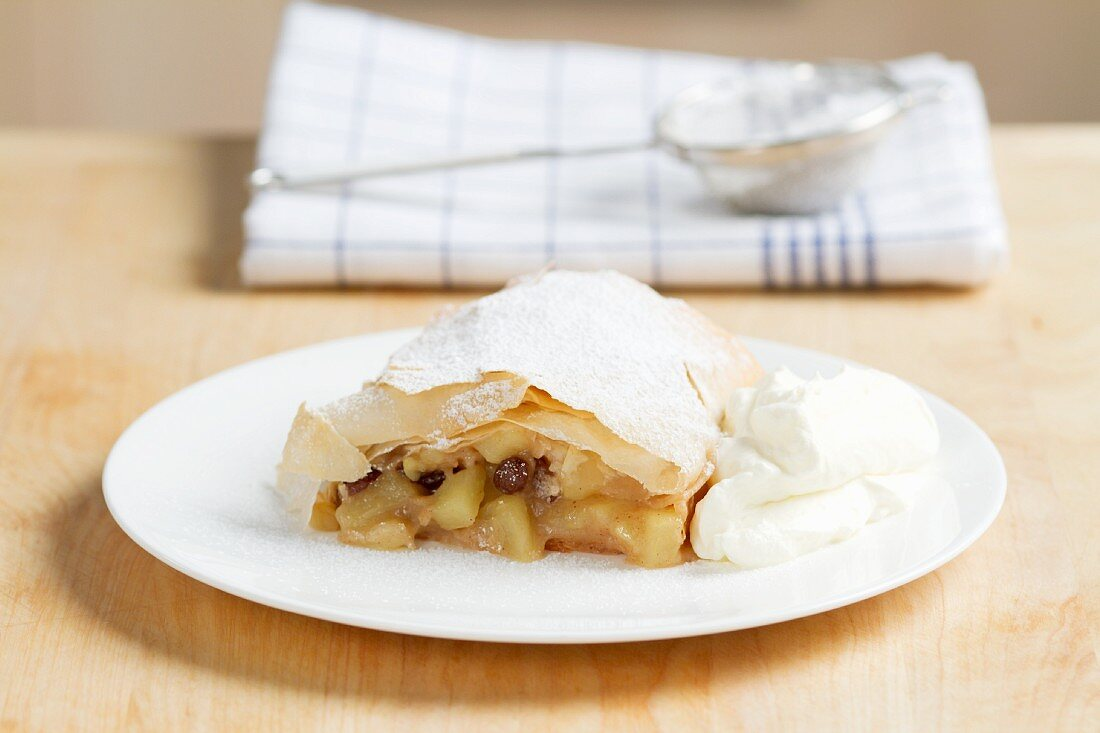 Apple strudel with cream