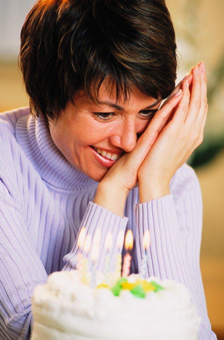 Happy woman with birthday cake