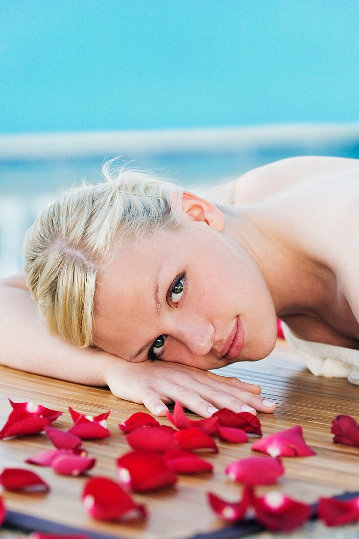 Woman lying by pool