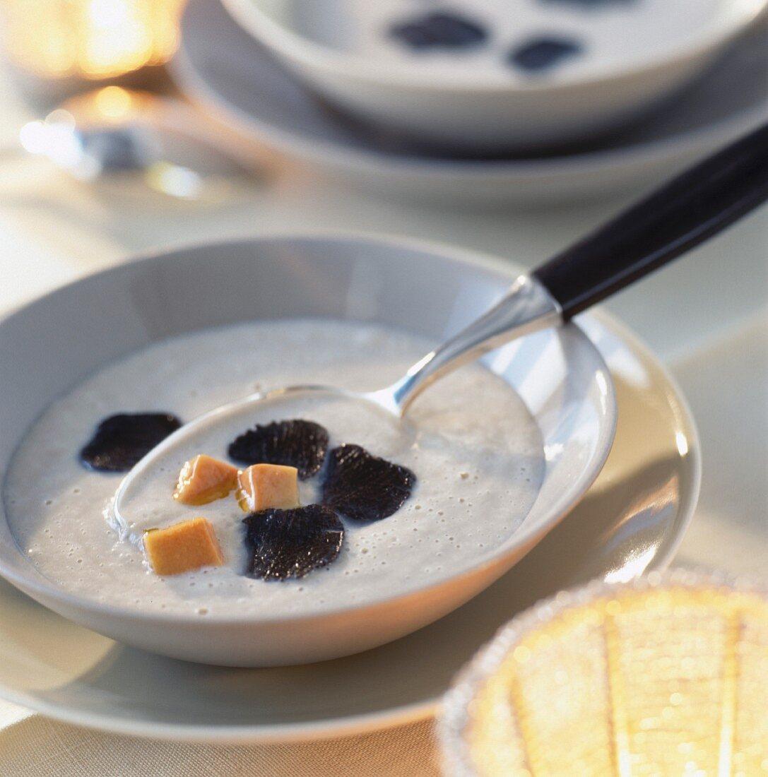 Foamy mushroom soup with truffles and diced foie gras