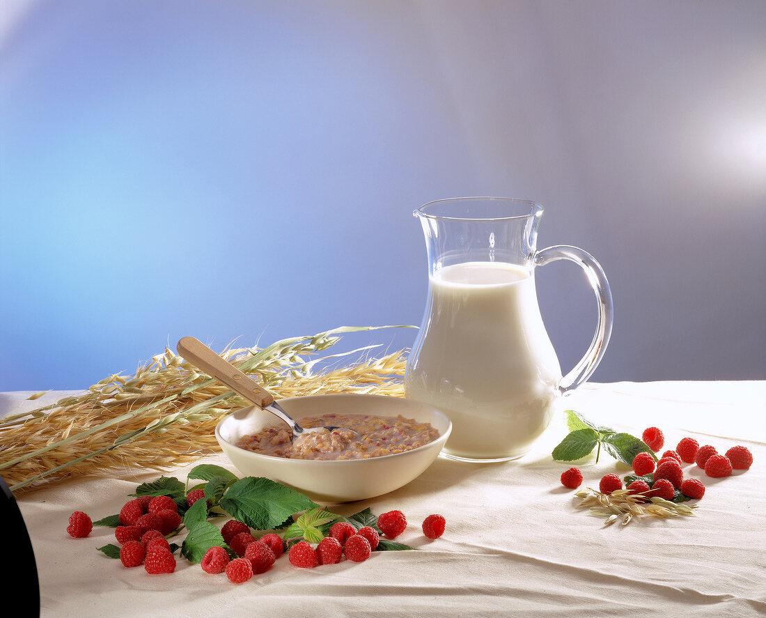 breakfast with milk, cereals and raspberries