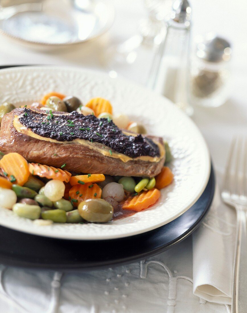 Lamb sirloin coated with tapenade and mixed vegetables