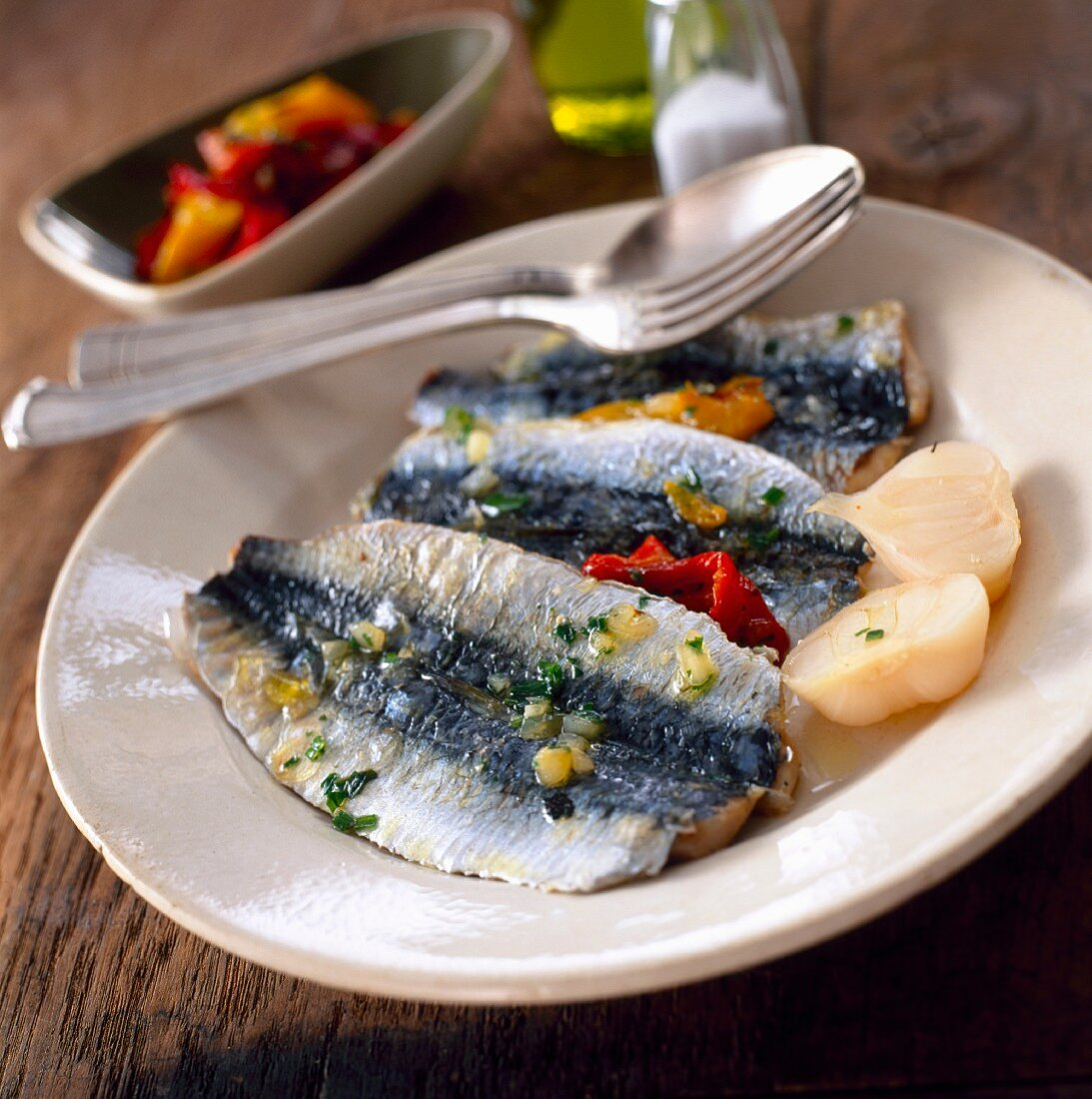 Sardine fillets with marinated peppers