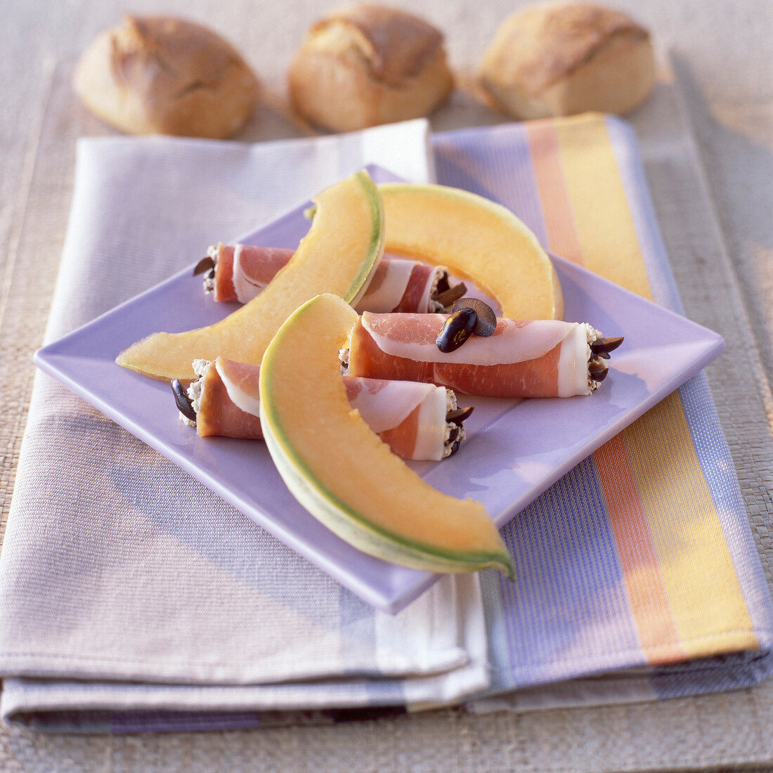 rolled parma ham and melon
