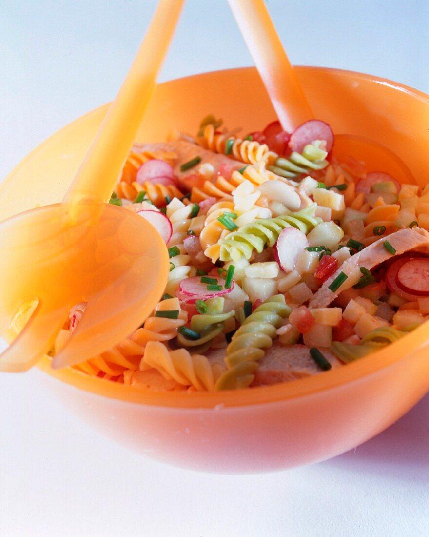 pasta salad radish tomatoes and cucumbers