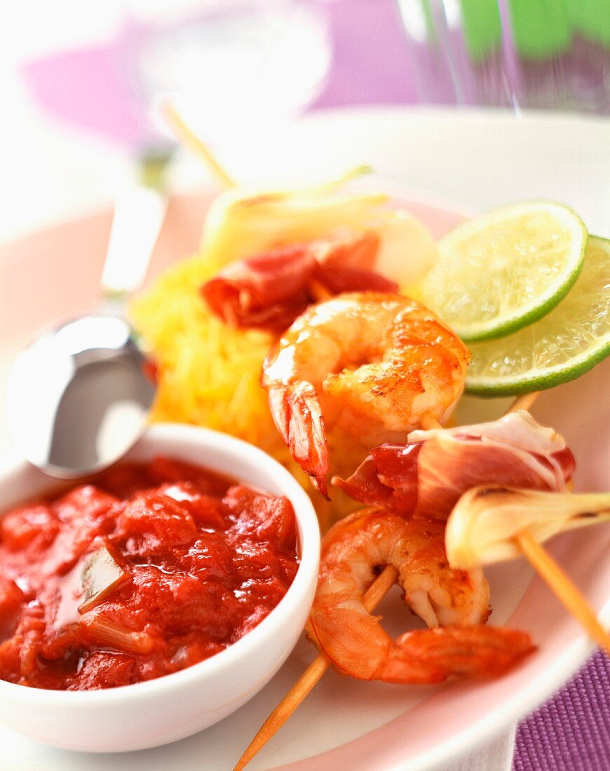 Prawn kebabs with stewed tomato sauce and saffron rice