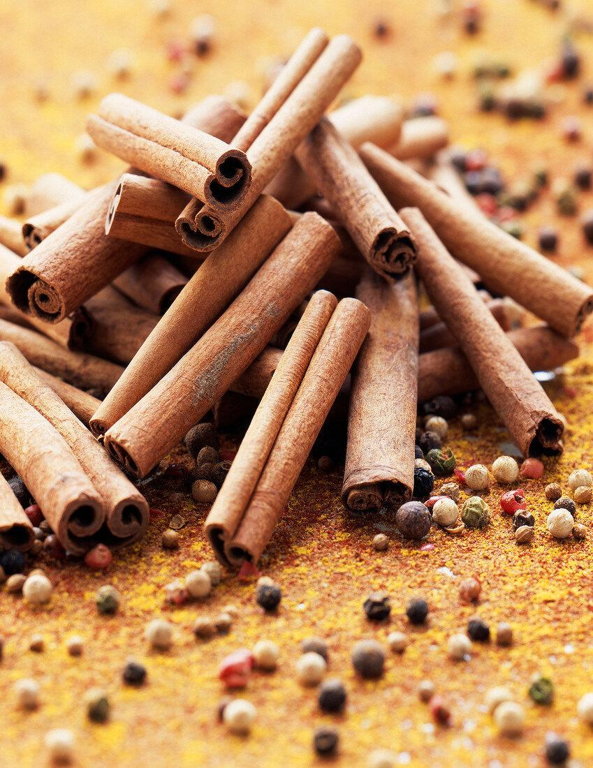 Cinnamon sticks and peppercorns