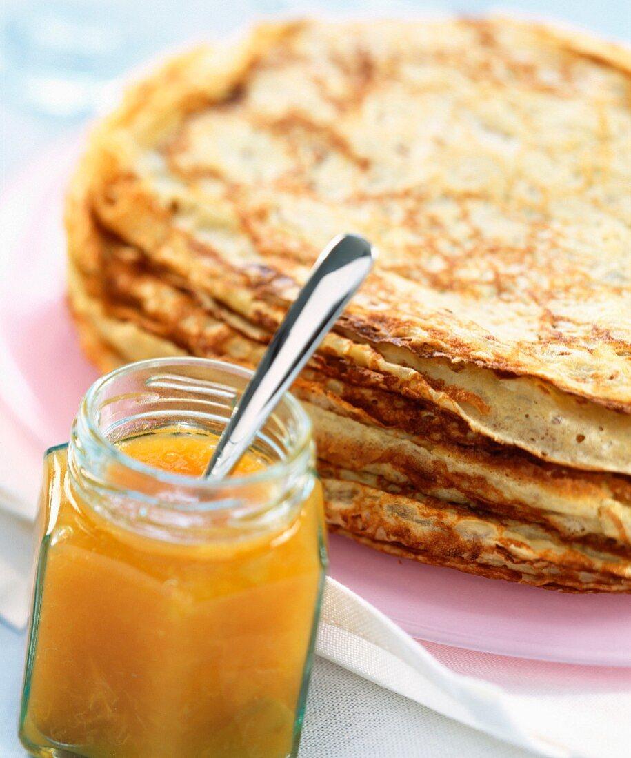 Pancakes and pot of jam