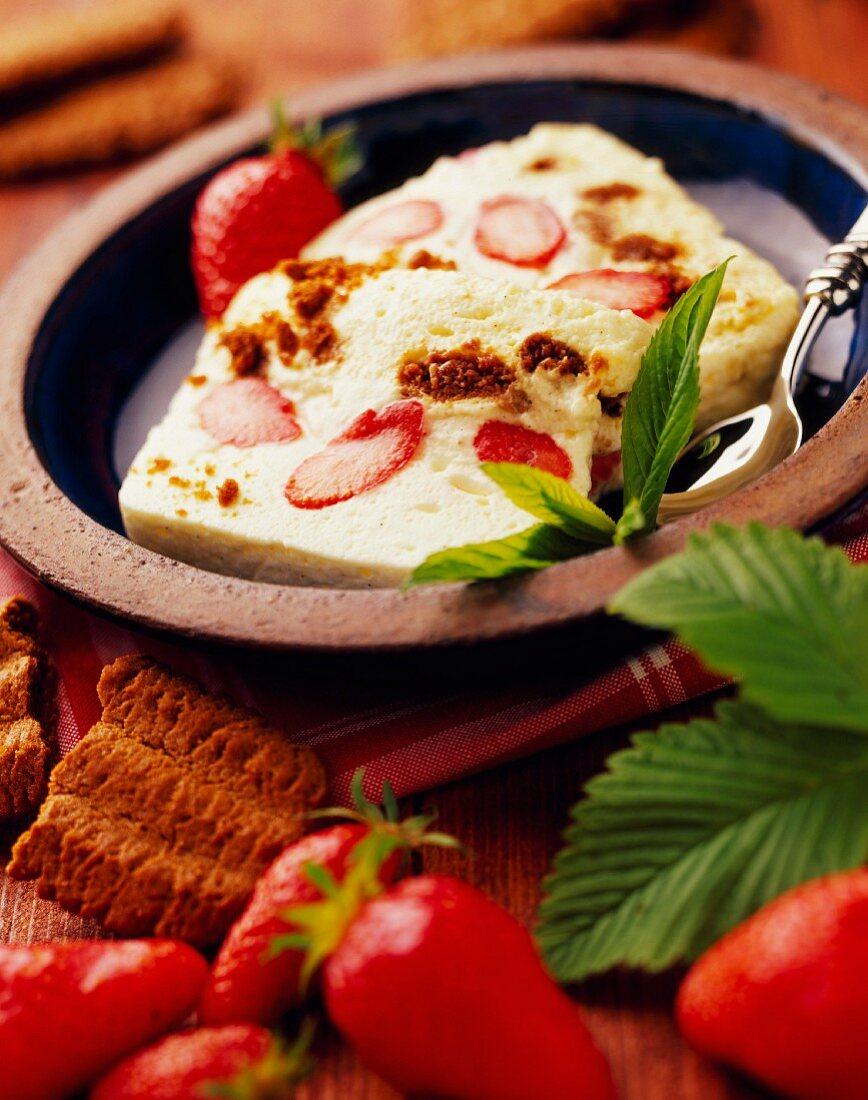 mascarpone cream dessert with strawberries and gingernut biscuits