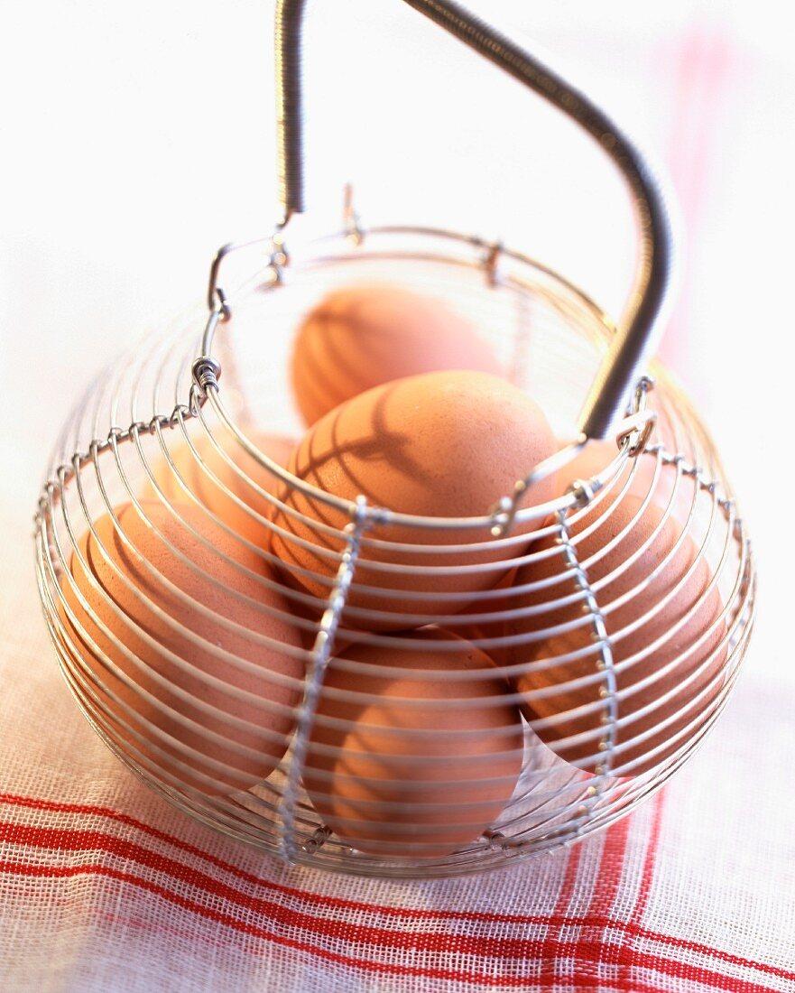 Metal basket of eggs
