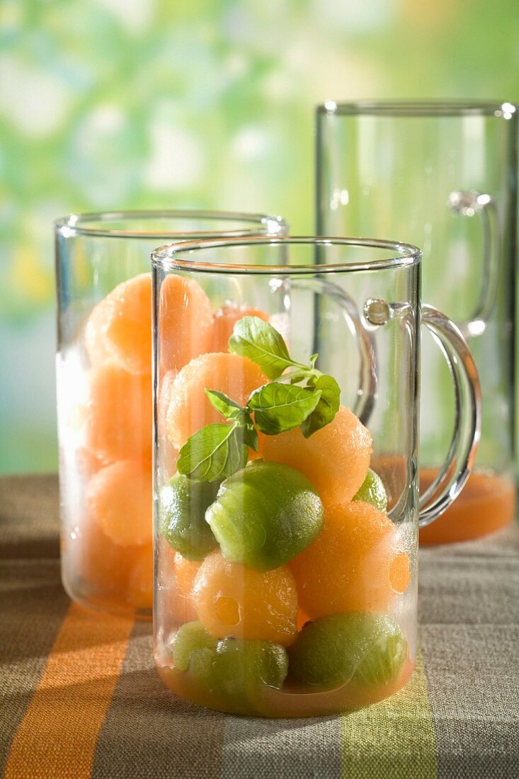 Melon and kiwi balls with basil