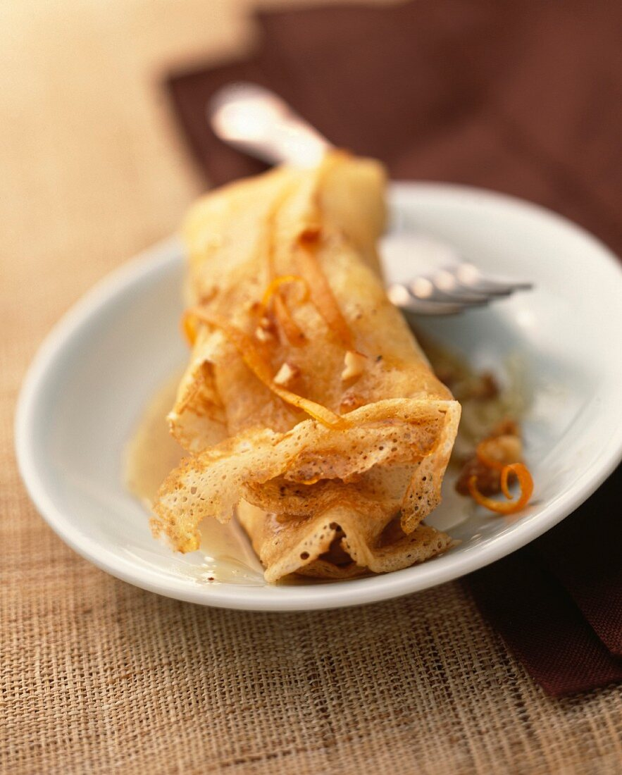 Pancake with orange cream and caramelized dried fruits