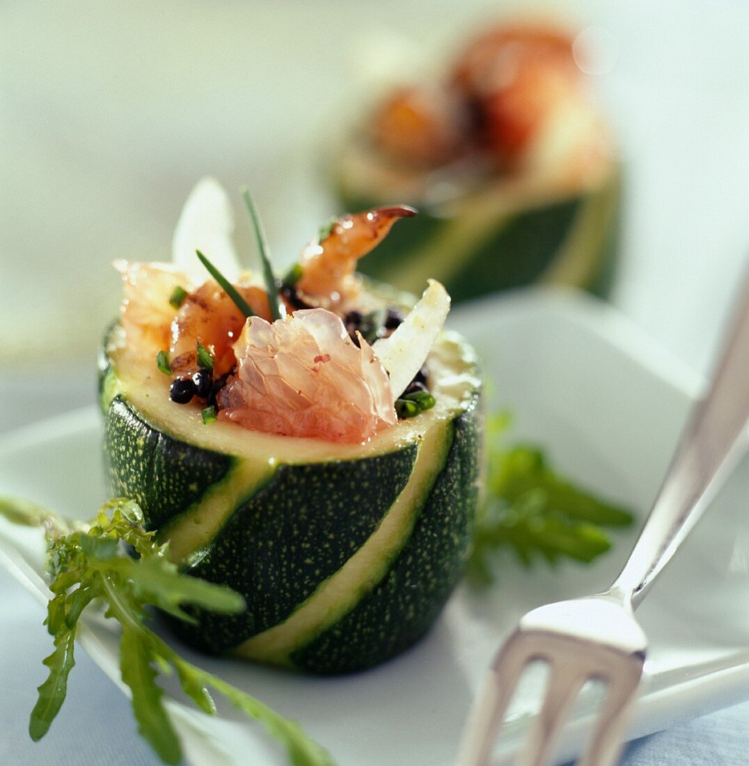 Courgette stuffed with prawns and grapefruit