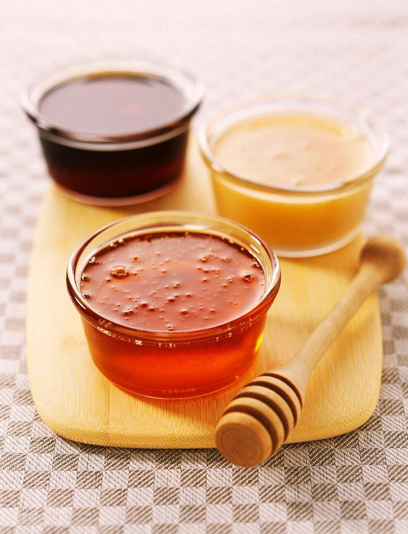 assorted mini jars of honey