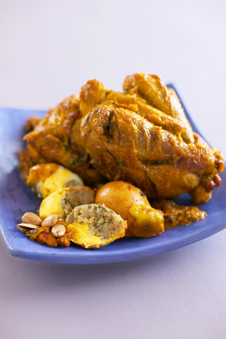 Chicken with eggs stuffed with almonds