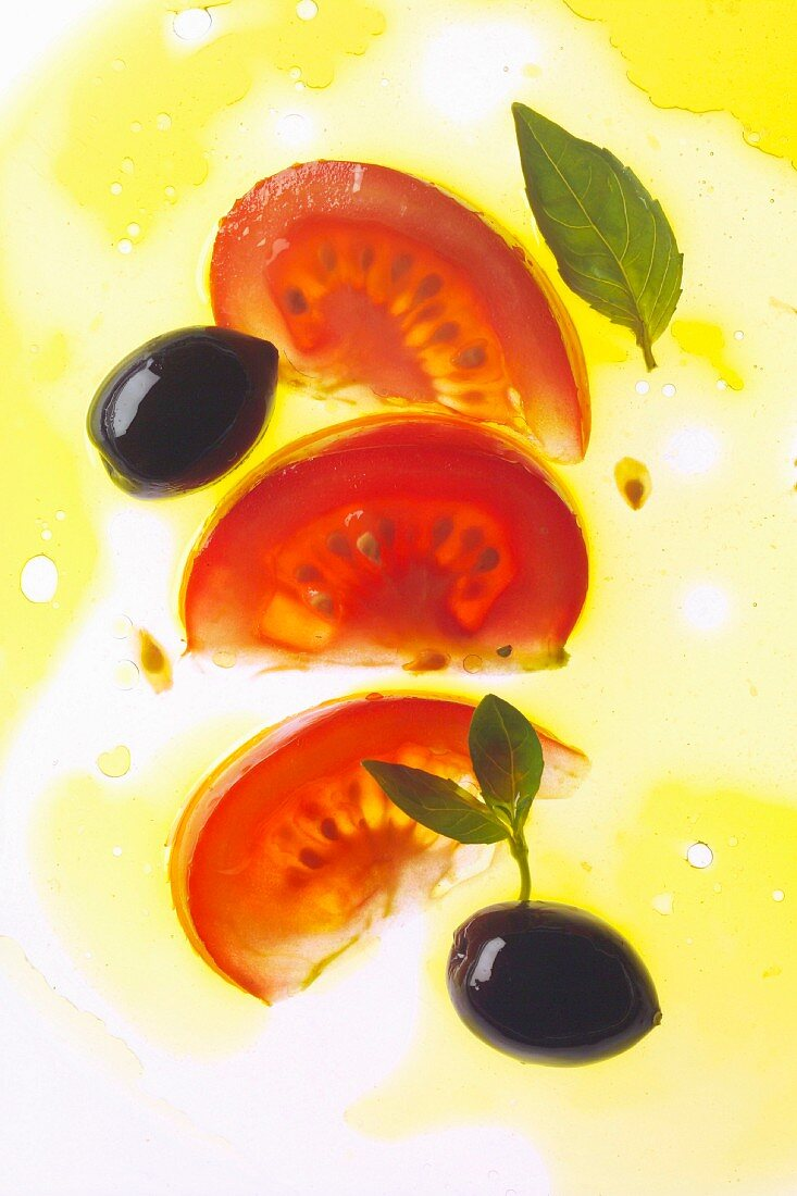 Cut tomato and olive in oil