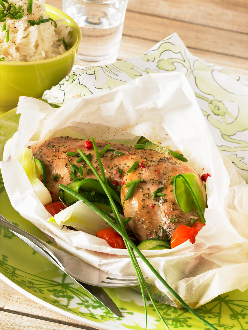 chicken and vegetables baked in paper