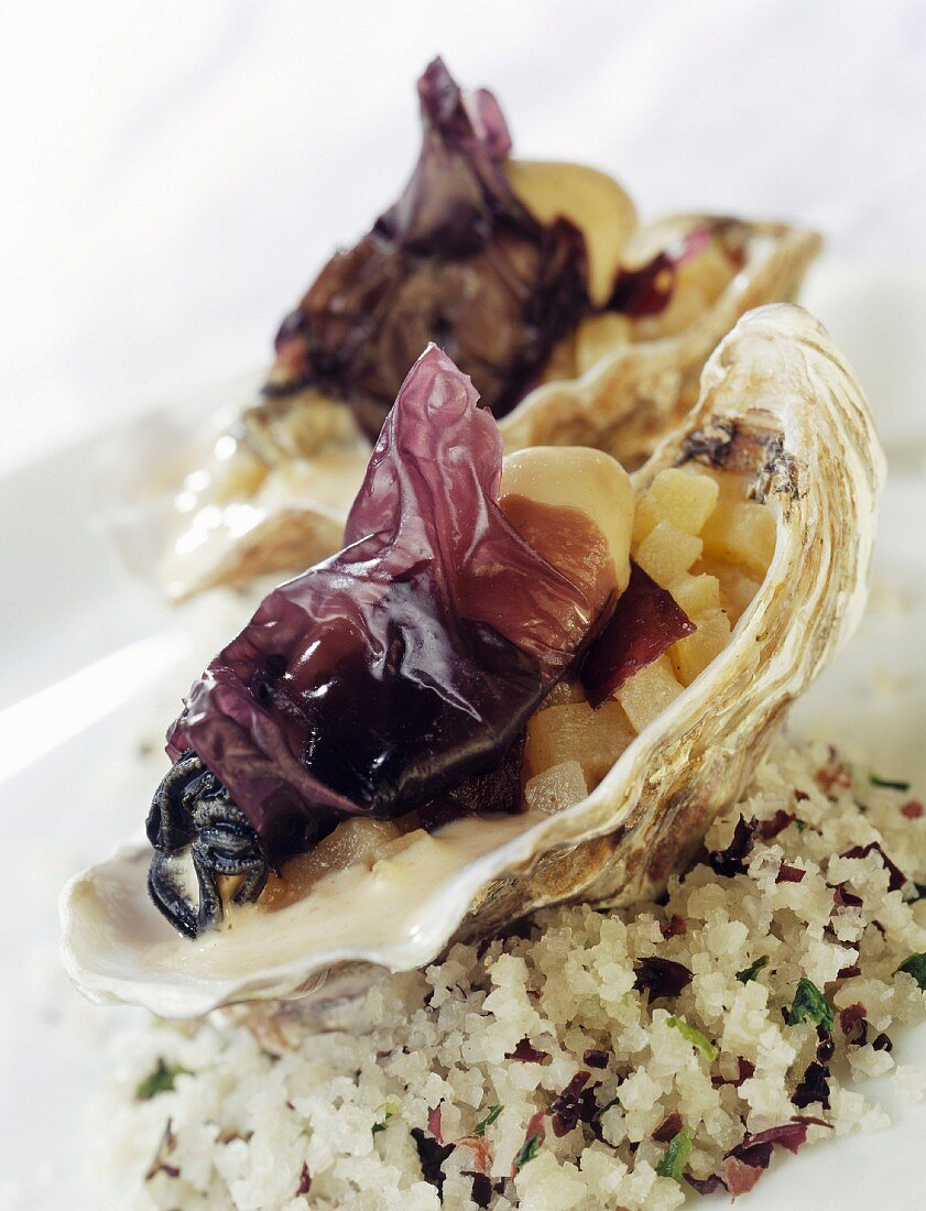 Oysters garnished with nori seaweed and dulse and diced apples