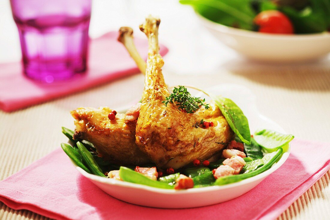 Roast chicken legs with sugar peas and diced bacon