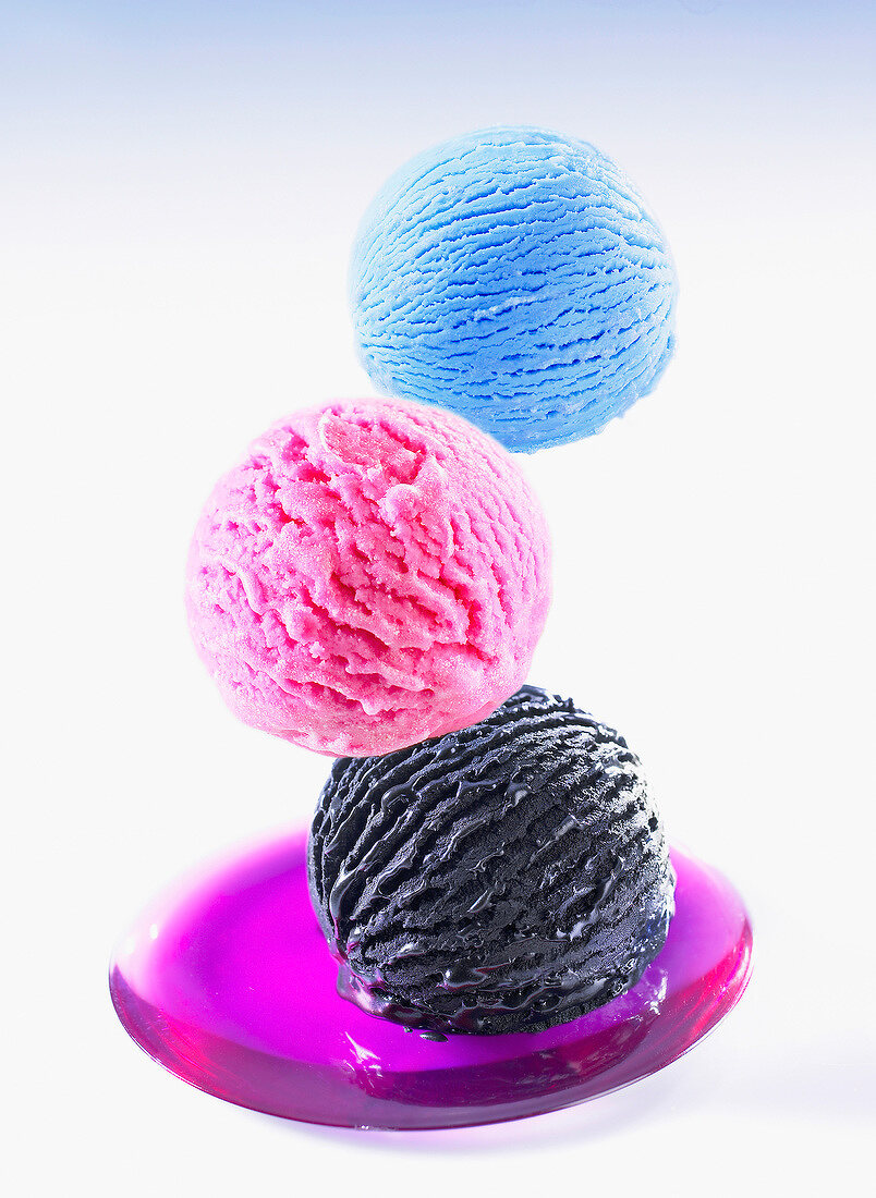Three scoops of different flavored ice creams