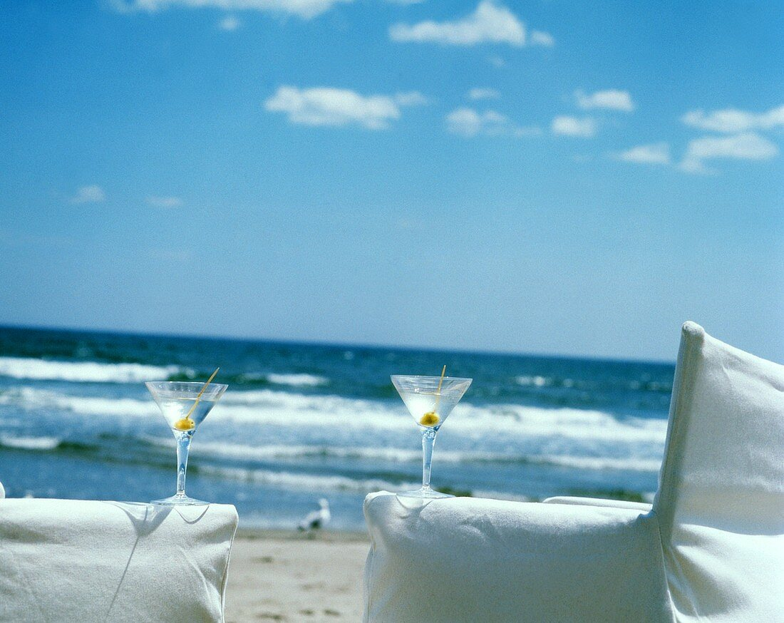 Two Martinis on Chair Arms at Beach