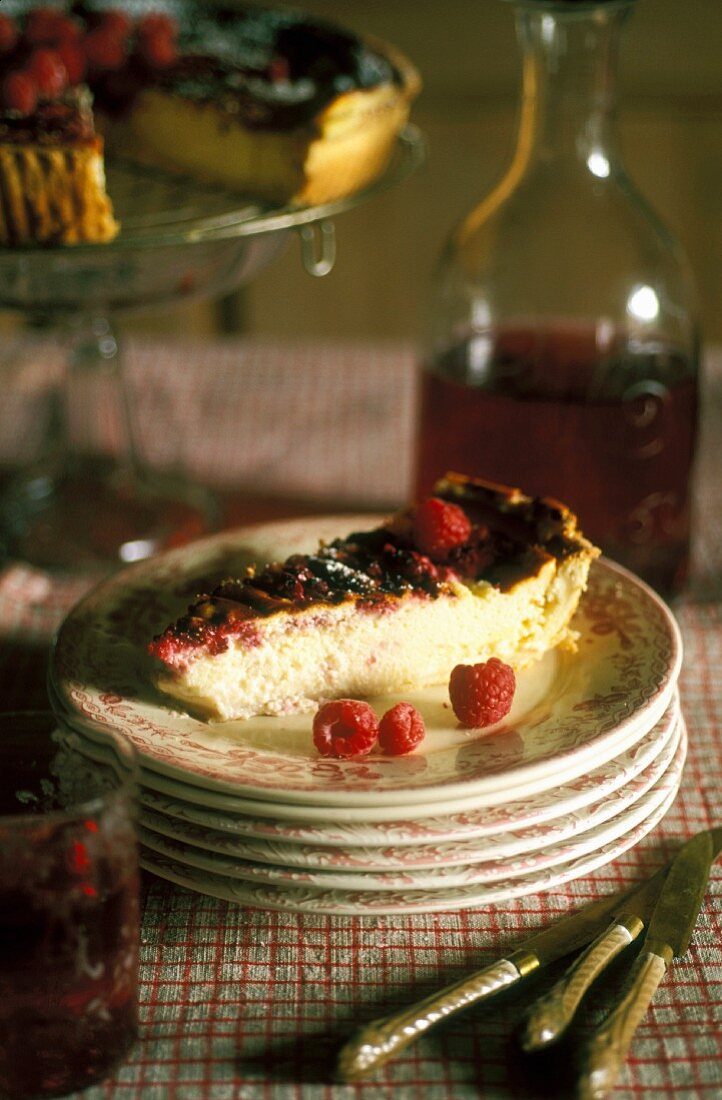 A slice of Alsatian raspberry cake on a stack of plates