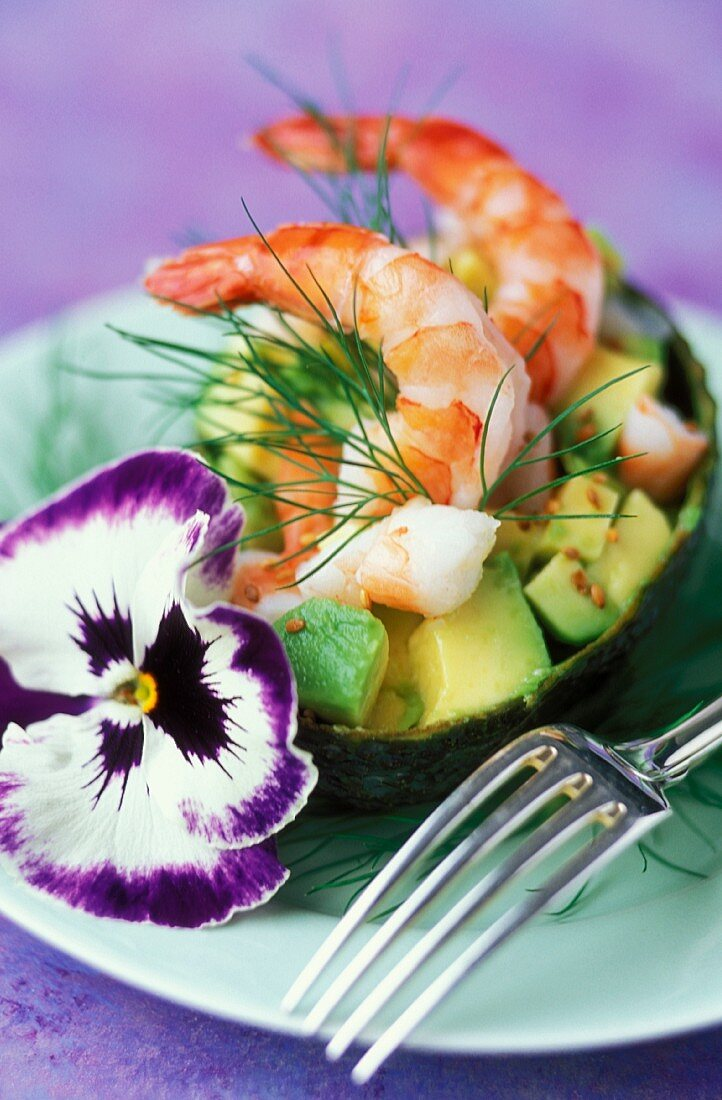 Avocado with prawns and pansies