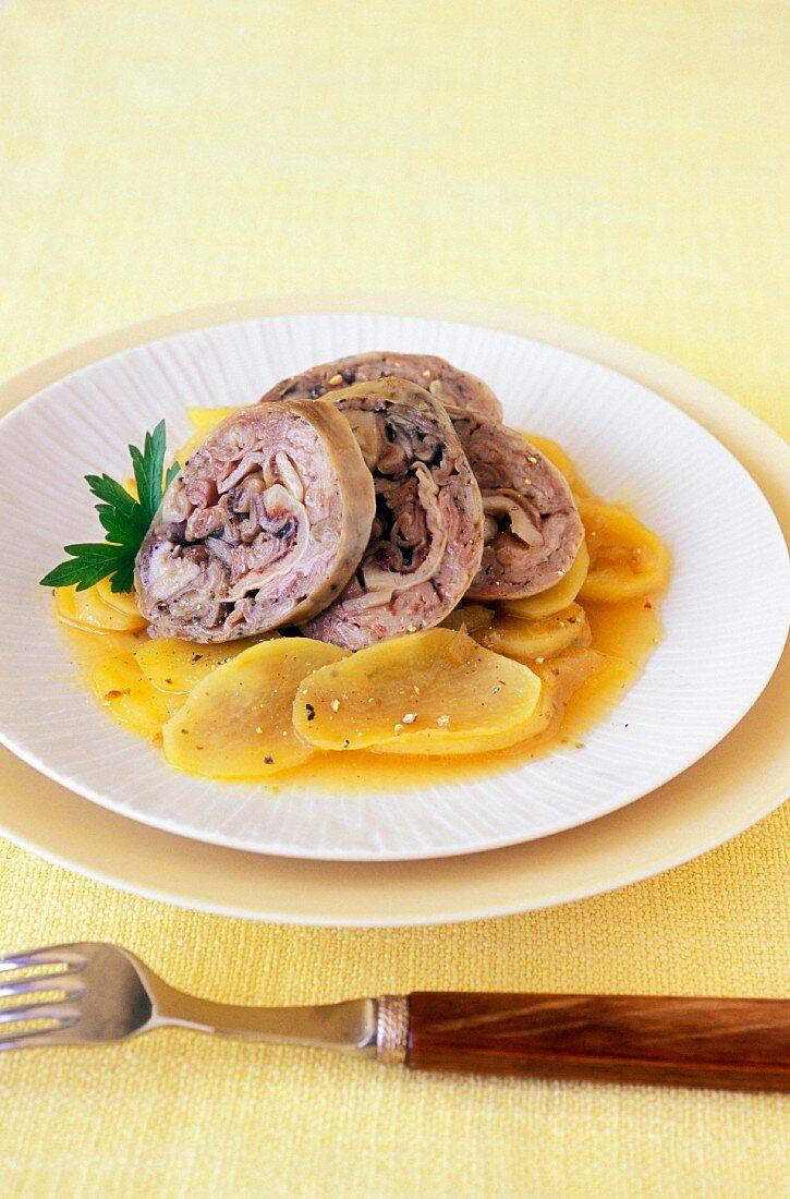 Potatoes à la boulangère with Andouille sausage
