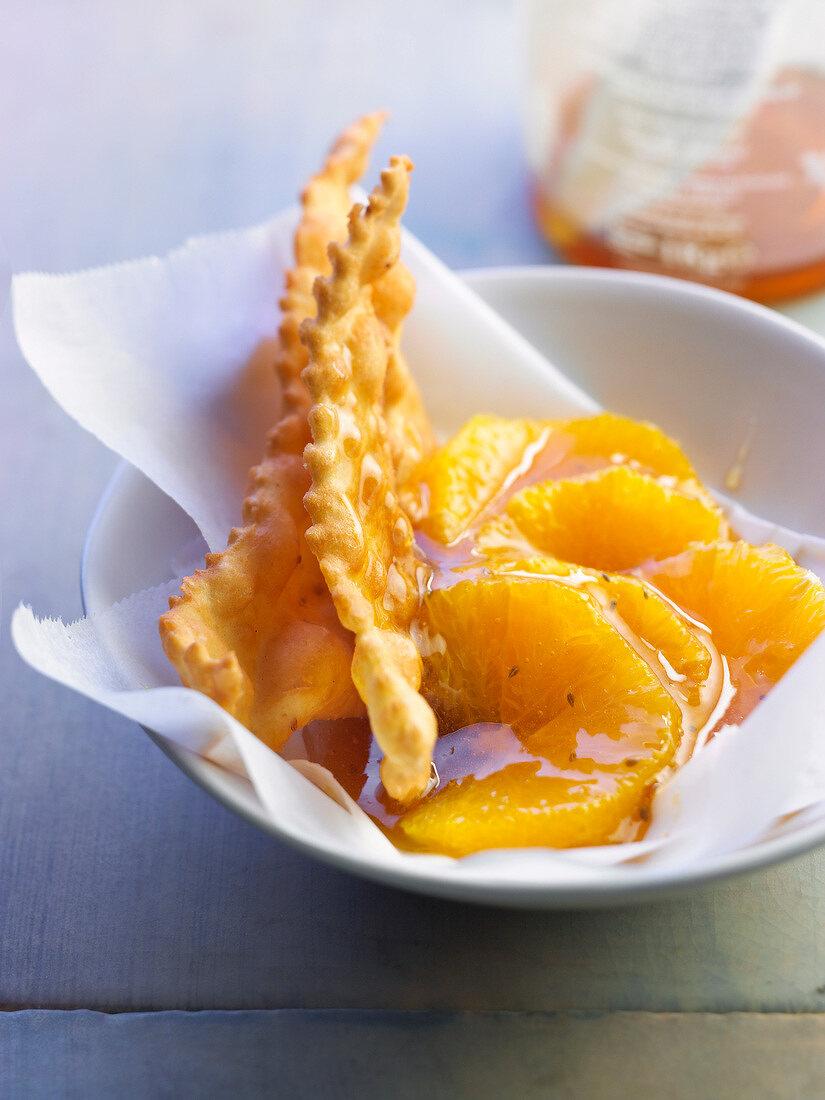 Fried pastry,orange fruit salad with honey and orange blossom