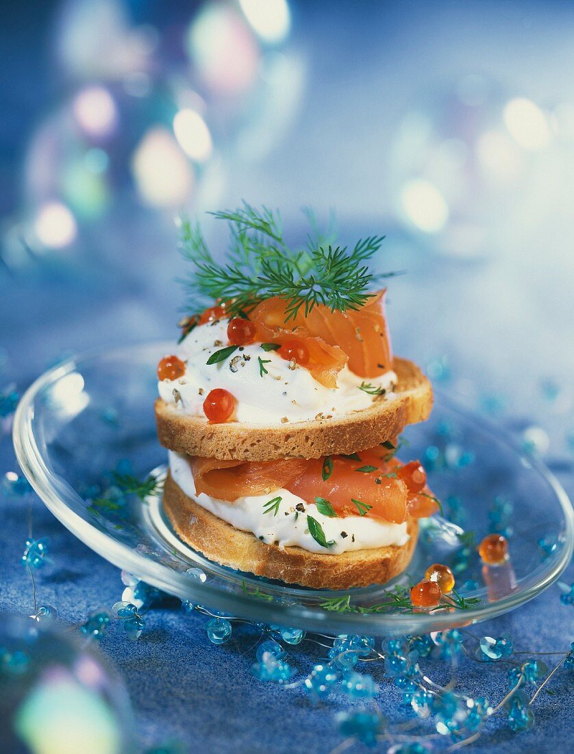 Slices of bread with salmon and ginger cream stacked on top of each other