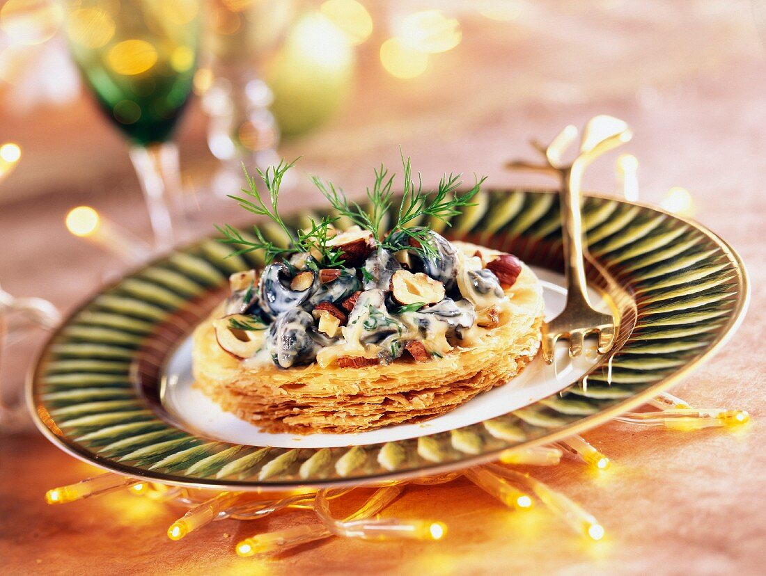 Puff pastry with snails and hazelnuts