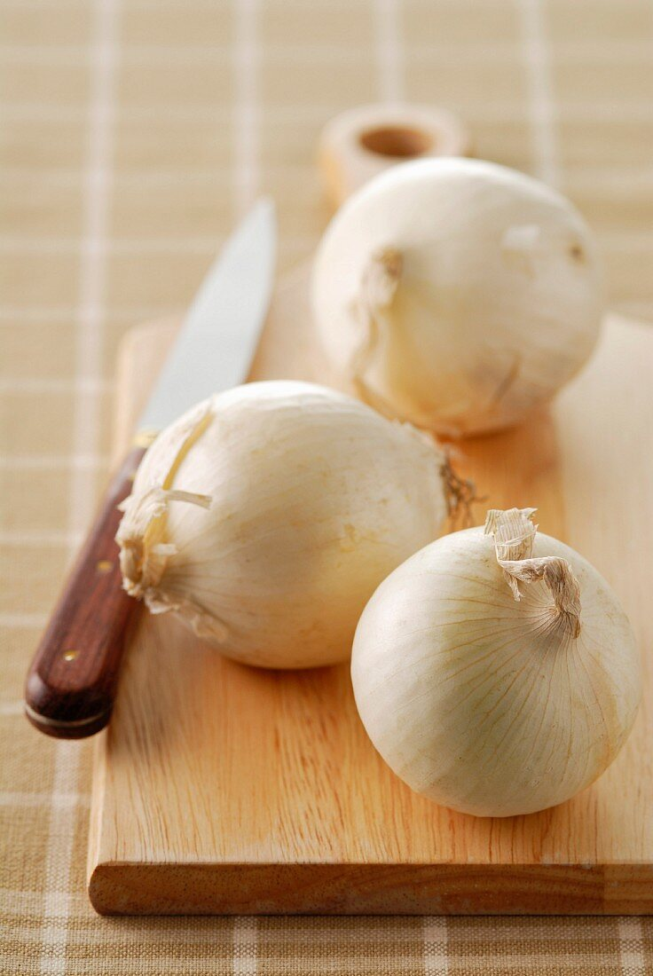 White onions on a chopping board