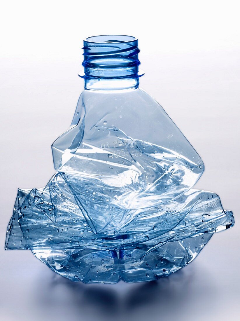 Crushed and empty plastic water bottle