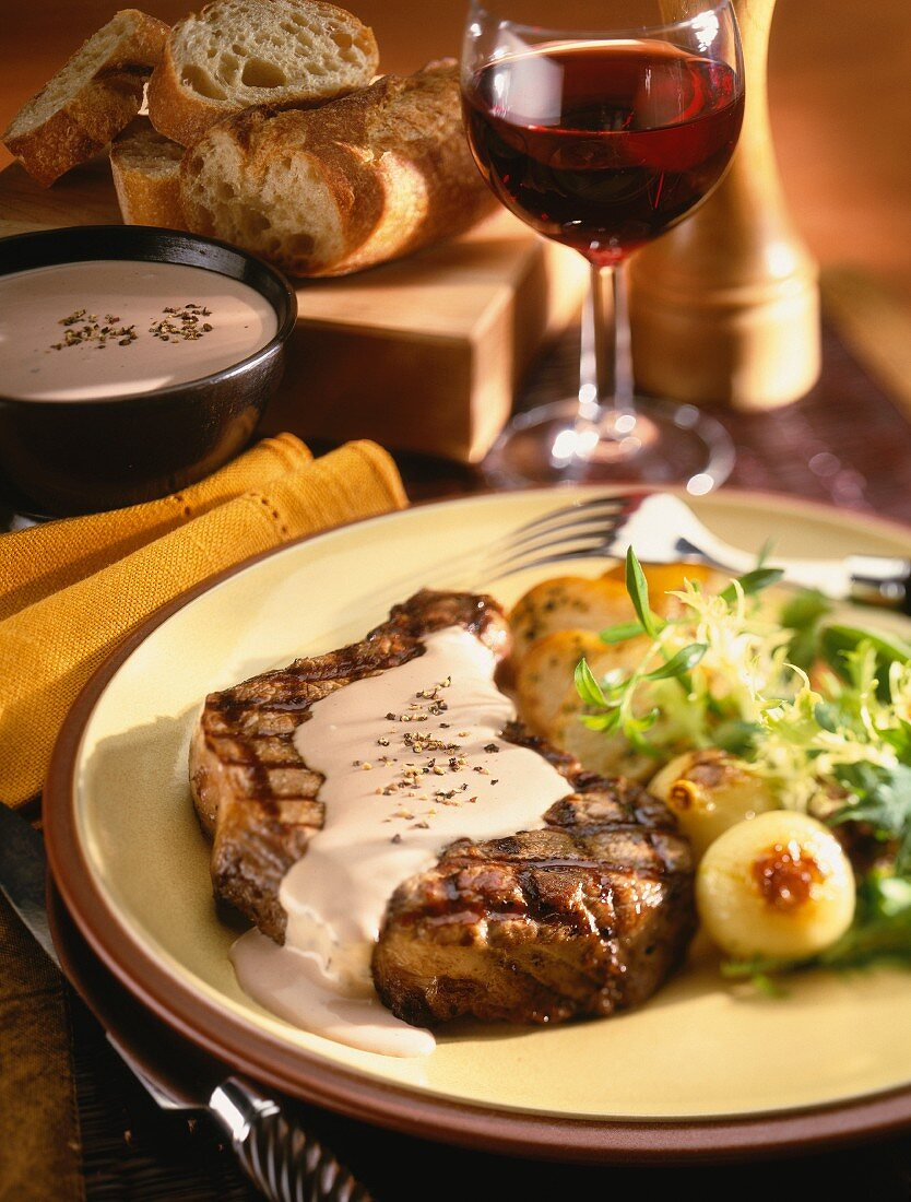 Grilled loin steak with pepper sauce
