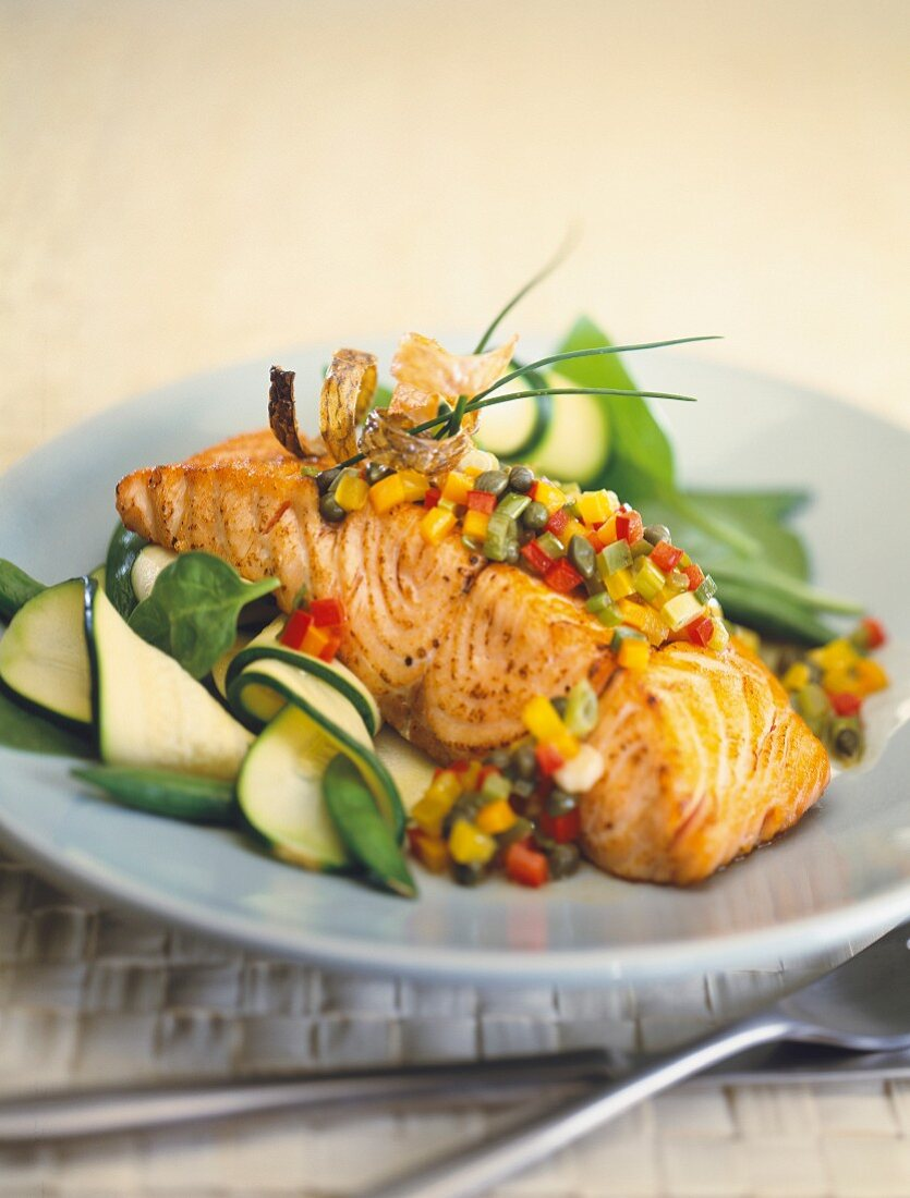 Fried salmon with vegetables tatar