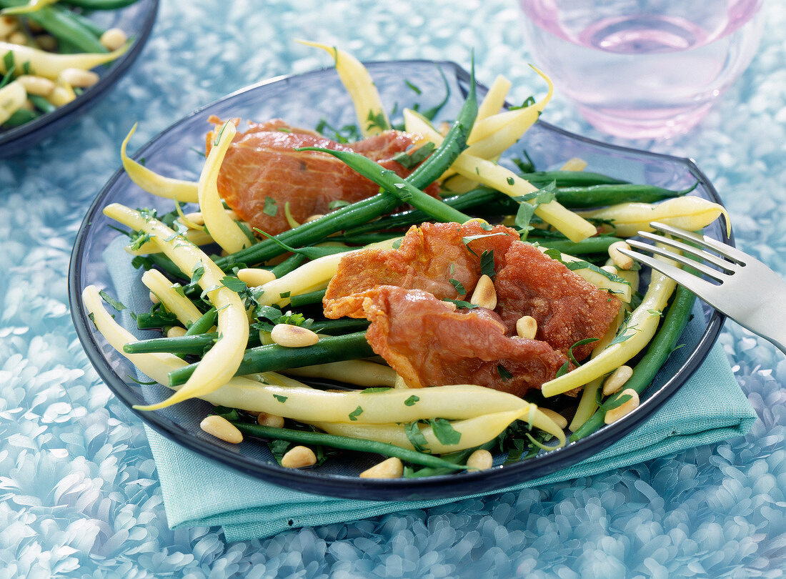 Green and white bean salad with pine nuts and grilled bacon