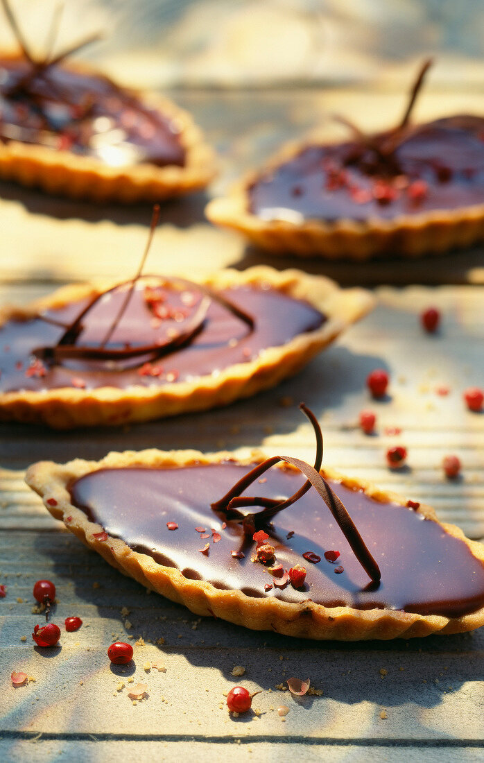 Chocolate and pink peppercorn shortbread tartlets