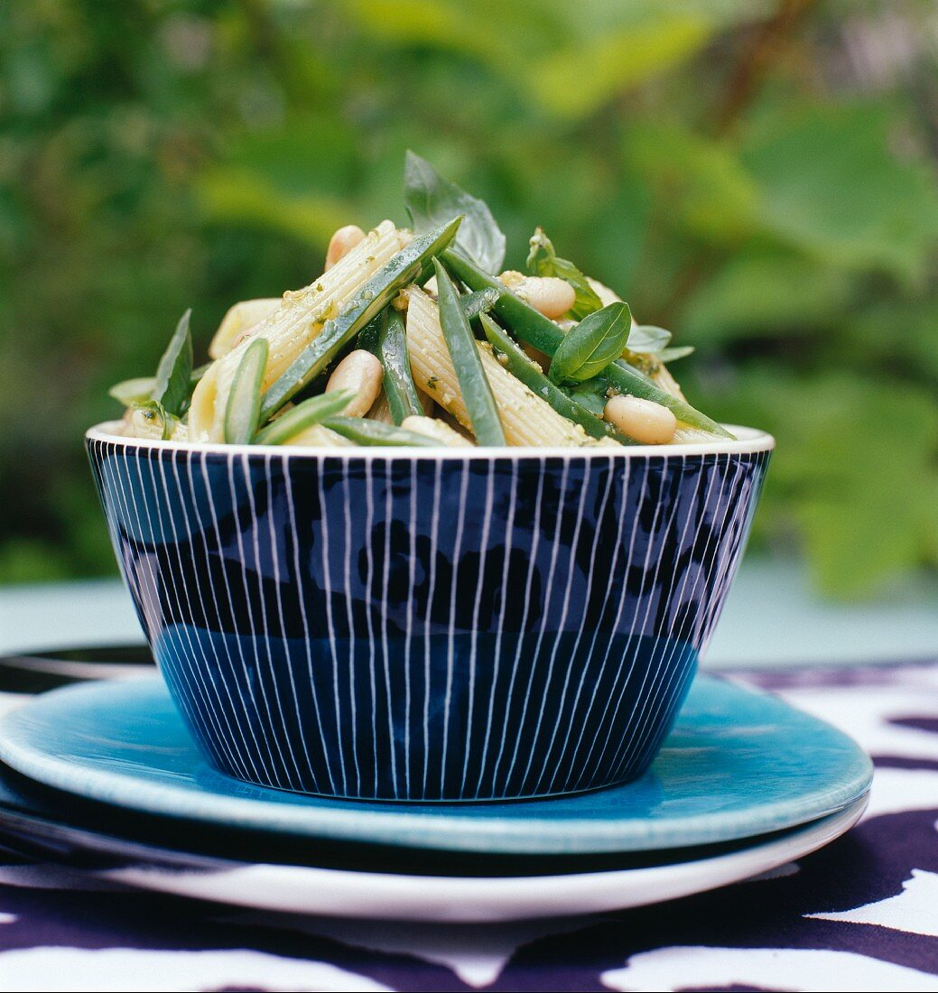 Penne salad with green vegetables and pine nuts