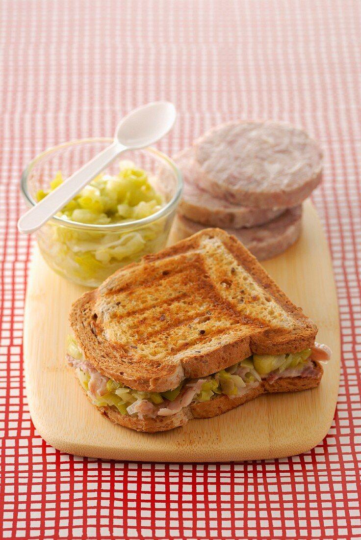 Guéméné chitterlings sausage toasted sandwich with leek fondue