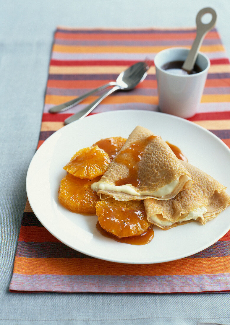 Pancakes with custard and orange salad with salted butter caramel
