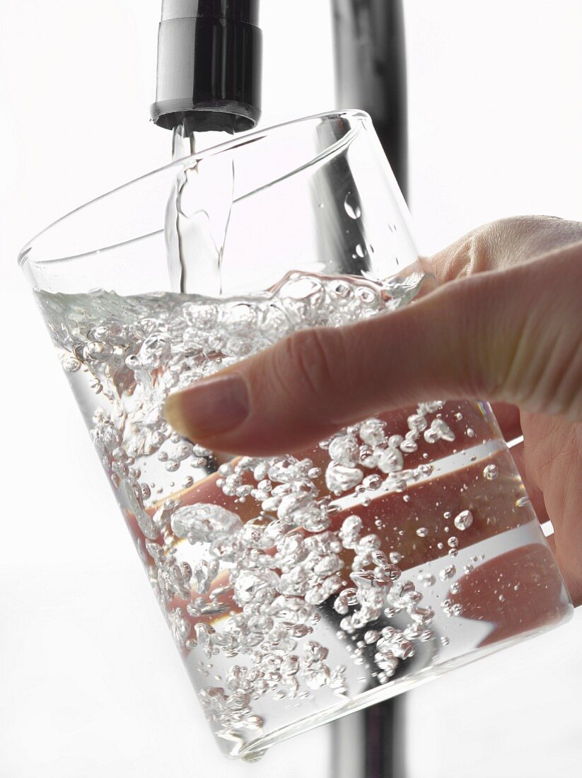 Filling a glass of water from th tap