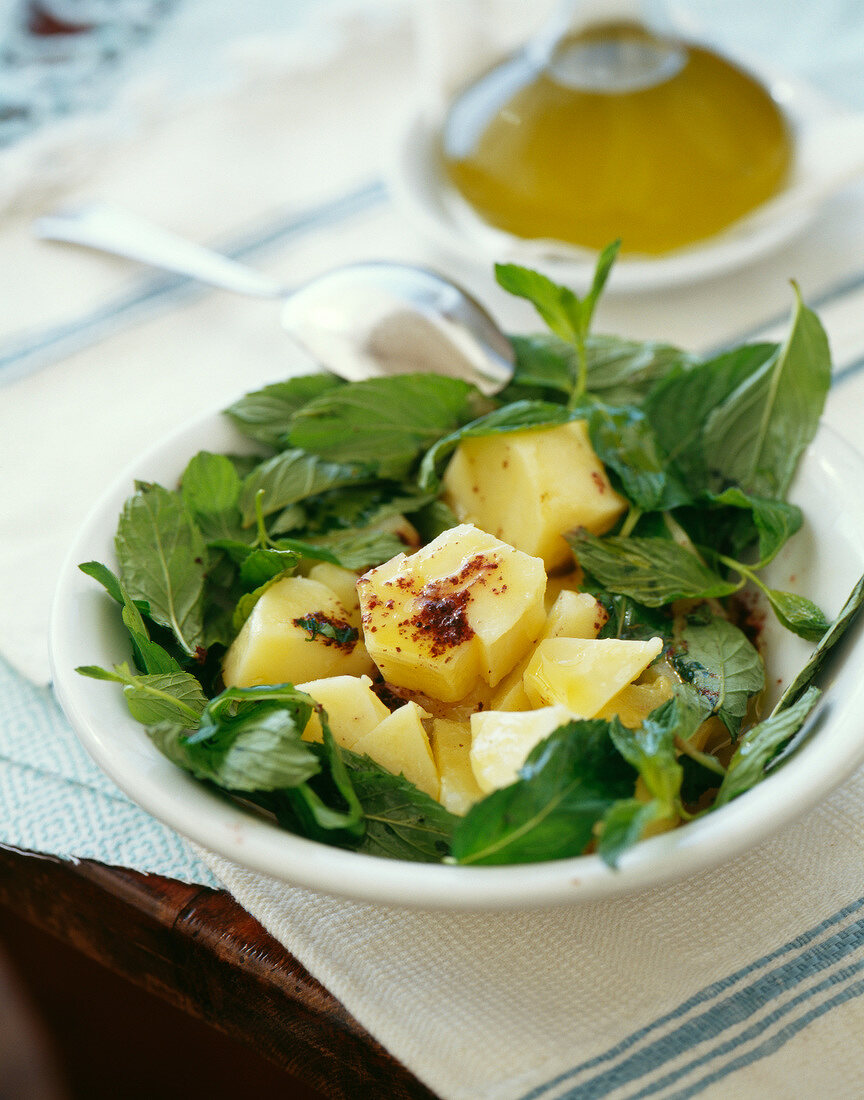 Potato salad with olive oil,fresh mint and spicies
