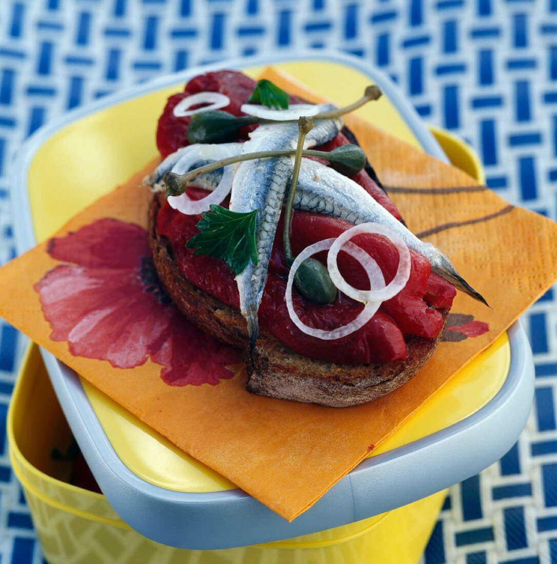 Piquillo peppers with fresh anchovies and capers on grilled bread