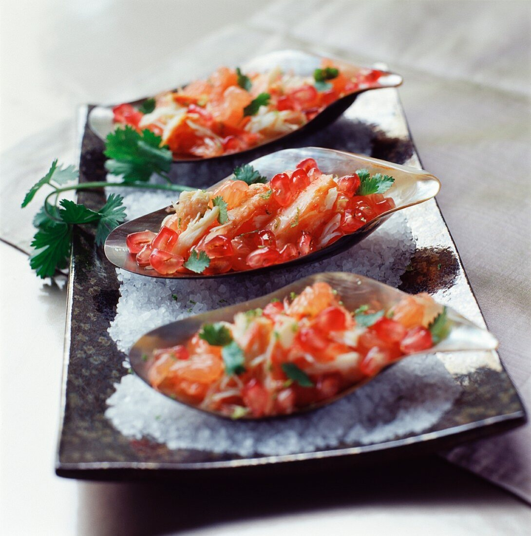 Refreshing canapés with crab, lanogustines and pomegranate