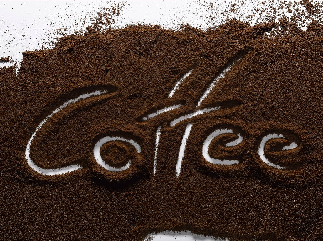 """""""The word """"""""coffee"""""""" written in ground coffee"""""""