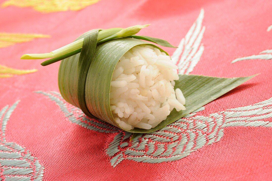 Steamed rice in a banana leaf