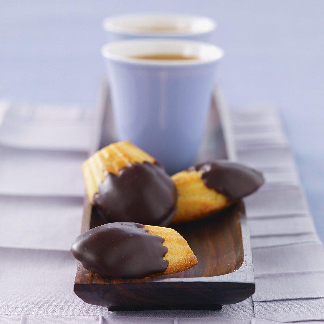 Madeleines half coated with chocolate